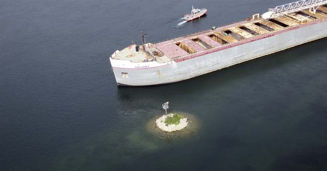 Freighter aground in river linking lakes Superior, Huron