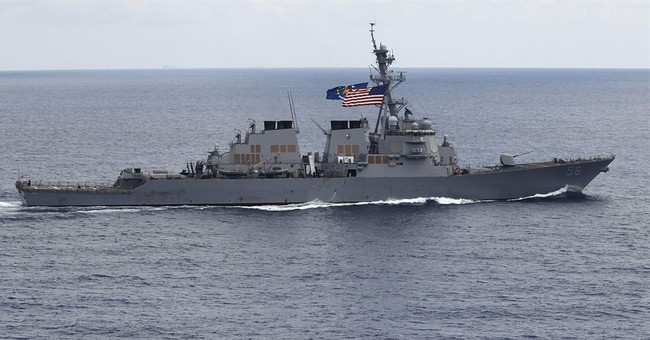 US warship sails close to China-held island in disputed sea
