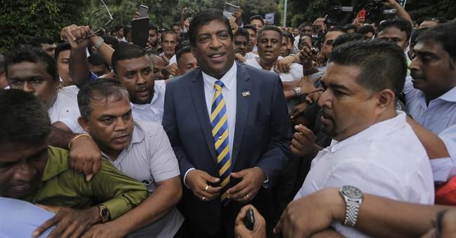 Sri Lanka foreign minister resigns over alleged scandal