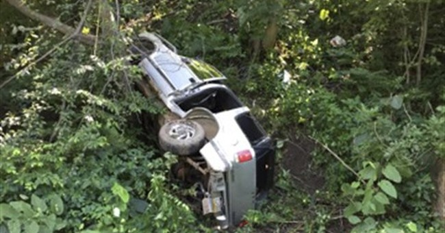 Police: Toddler OK after ride down 100-foot-high hill in SUV