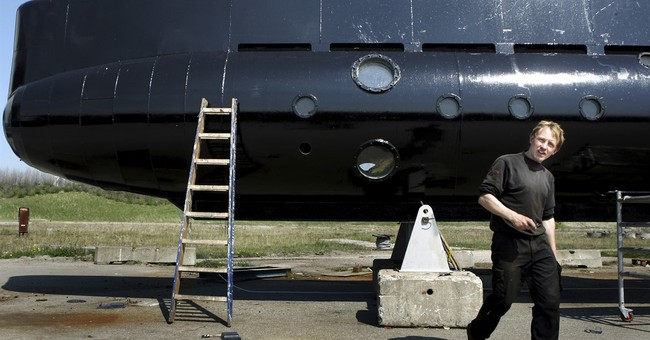 The Latest: Submarine owner held in missing woman's death