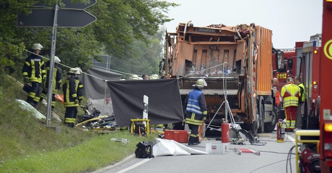 Report: 5 killed as German garbage truck tips onto car