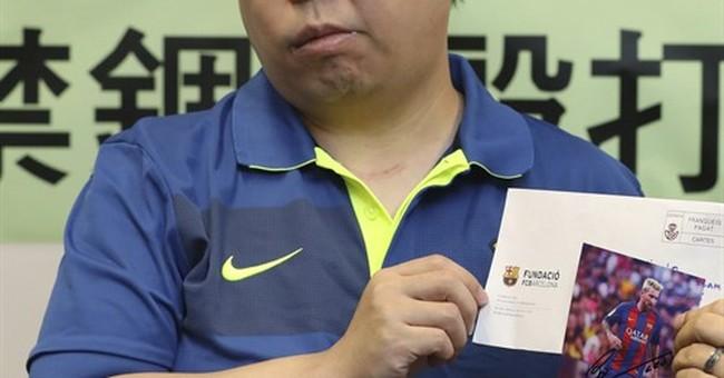 Hong Kong activist arrested over allegation of stapled legs