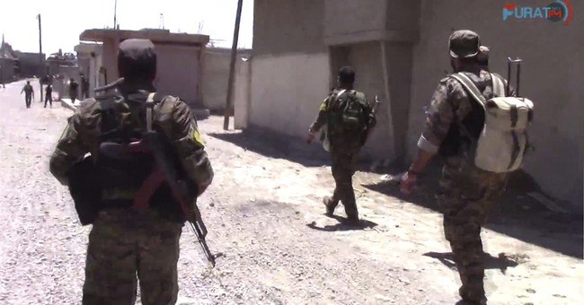 US-backed Syrian fighters link up from east, west in Raqqa