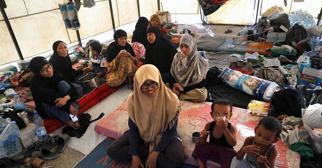 Official: Indonesian family that joined IS now in Iraq