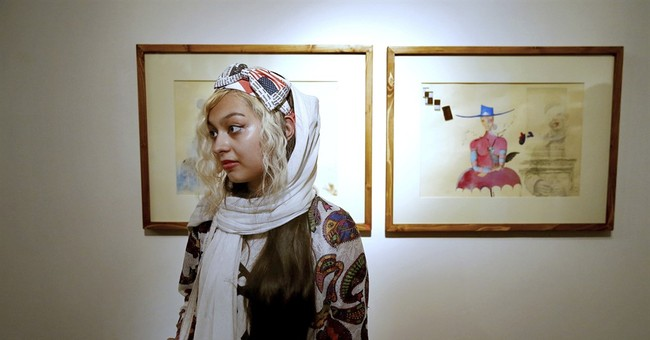 Iran opposition leader's daughter holds painting exhibition