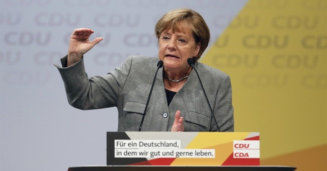Merkel emphasizes German prosperity, security at rally