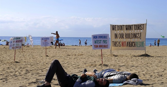Barcelona residents protest unchecked growth of mass tourism