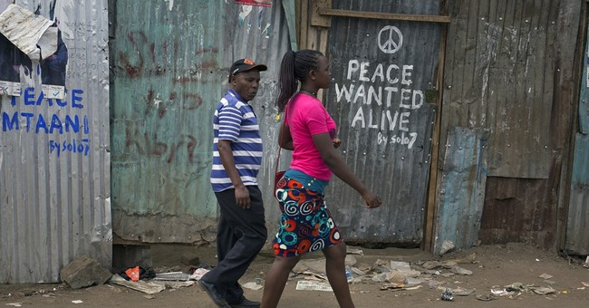 Kenyan graffiti artists spray peace slogan in troubled areas