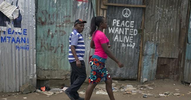Kenyan graffiti artists spray peace slogan in troubled areas