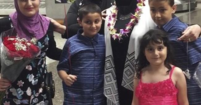 APNewsBreak: Grandmother in travel ban lawsuit arrives in US