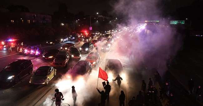 Hundreds protest in Oakland over deadly Virginia rally
