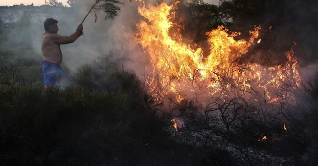 The Latest: Fires stretch Greek firefighting capabilities