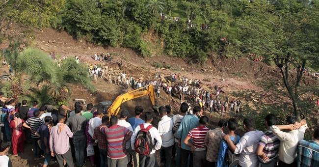 Rescuers pull out 13 bodies after landslide hits north India