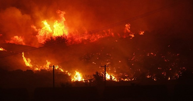 Wildfire burns home, leads to evacuations in Washington
