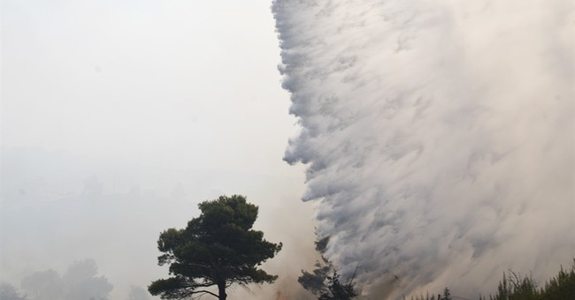 The Latest: Greek island wildfires prompt state of emergency