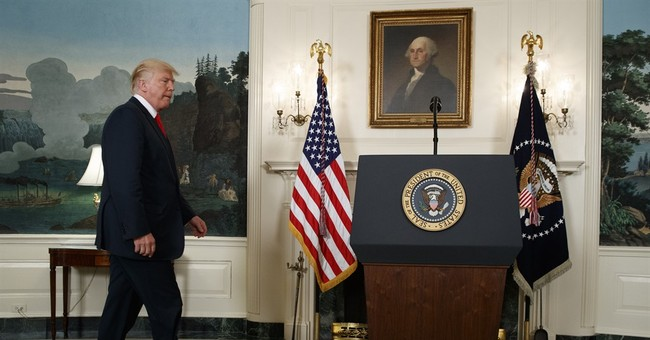 Bowing to pressure, Trump denounces hate groups by name