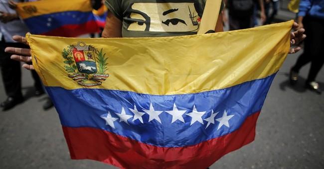 Maduro supporters march in Venezuela against Trump