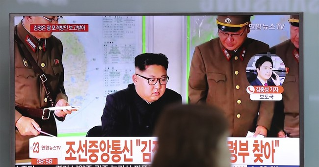 China tells US, North Korea to 'hit the brakes' on threats