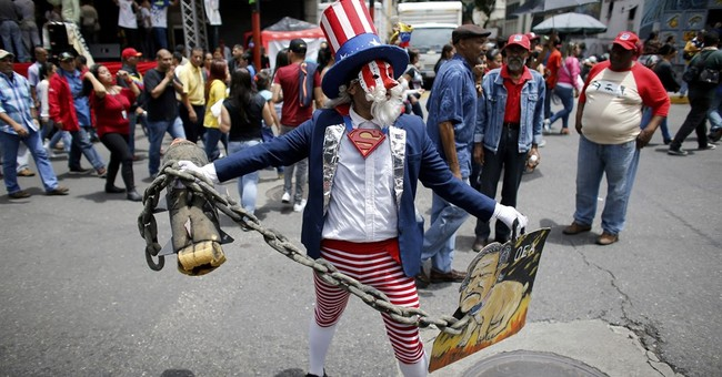 Maduro supporters march in Venezuela against Trump