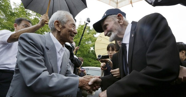 The Latest: US WWII vet says he, Japan family can move on