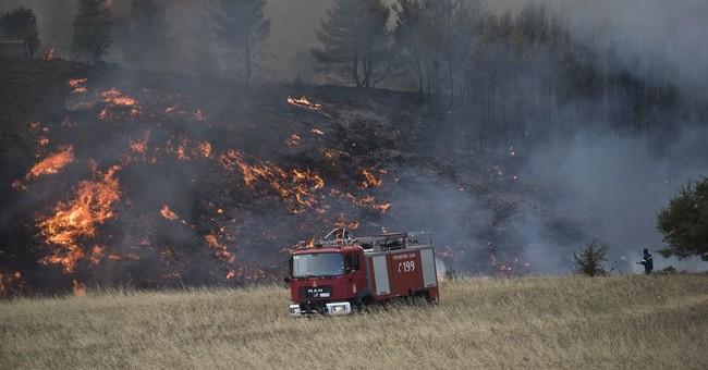 The Latest: Greece seeks EU help with major forest fire