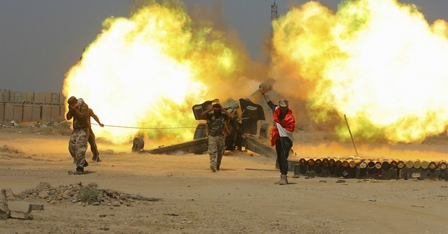 Thousands flee as Iraq steps up airstrikes on IS-held town