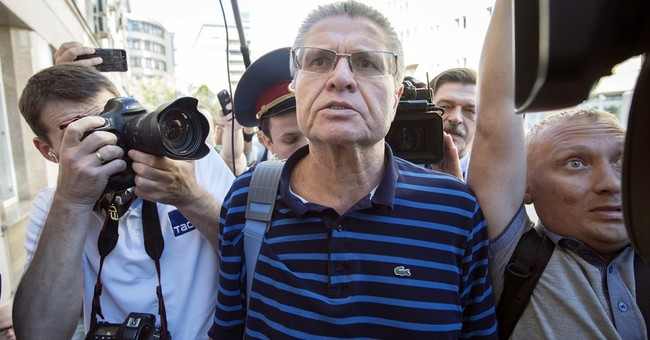 Russian ex-minister on trial for bribery blames Putin ally
