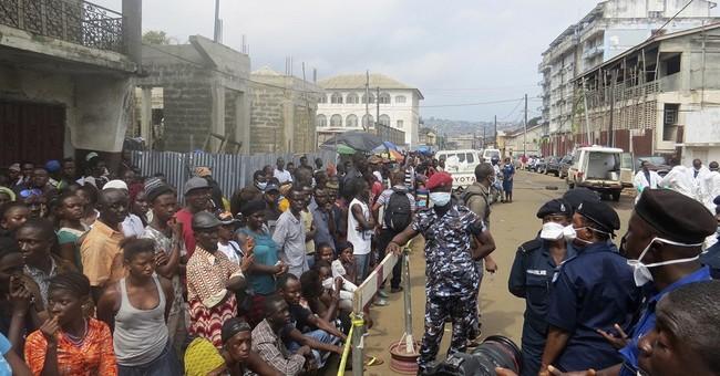 Threat looms of more mudslides in Sierra Leone amid burials