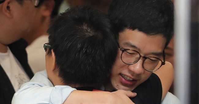 The Latest: Court sends Hong Kong activists to prison