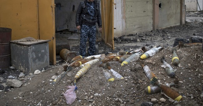 Clearing Iraqi cities of explosives may take decades