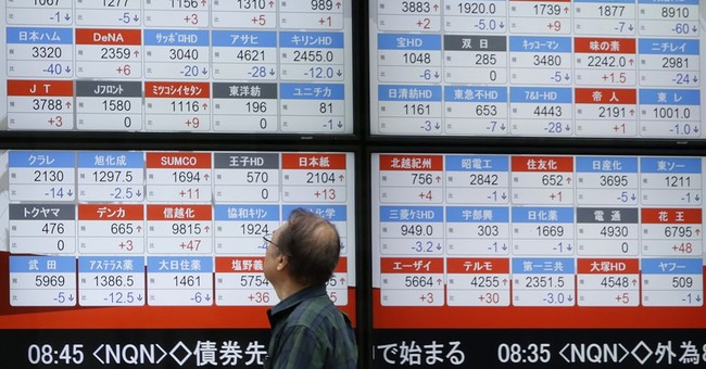 Global stocks slip as investors digest central bank reports