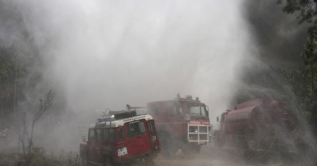 The Latest: Wildfires threaten villages on Balkan coast