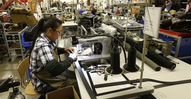 US factory output down in July on tumbling auto production