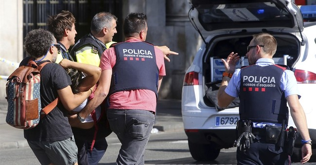 The Latest: Catalan govt ties attacks in Cambrils, Barcelona