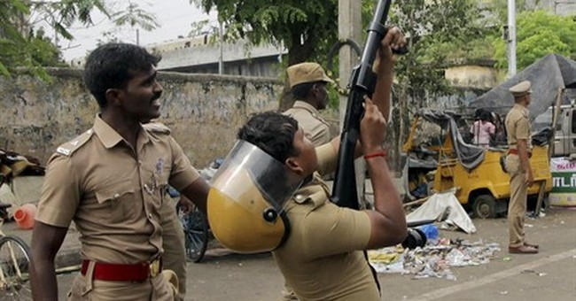 Fans of bull-taming sport attack police station in India