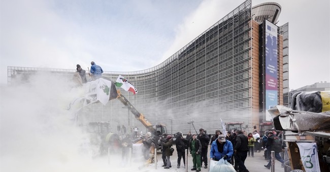 Dairy farmers spray EU HQ to push demands for better prices