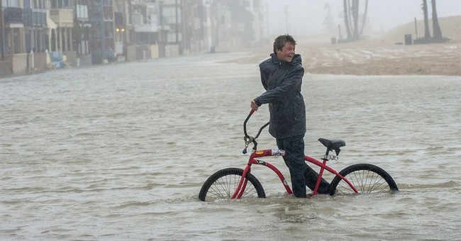 The Latest: State of emergency declared for 50 counties