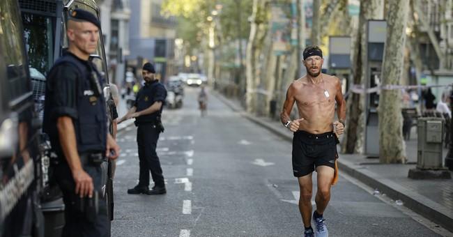 Memorials grow along site of deadly attack in Barcelona