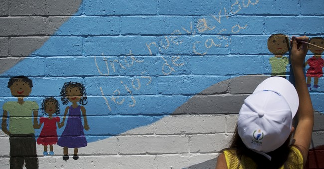 Migrants paint hopes and dreams on murals