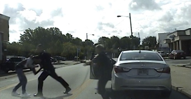 Dashcam video shows white cop punching black man during stop