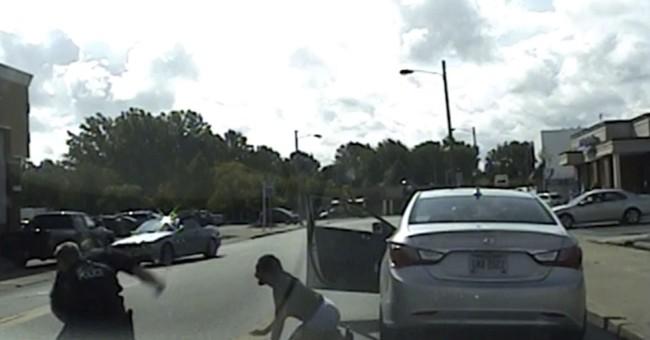 Dashcam video shows white cop punching black man during stop
