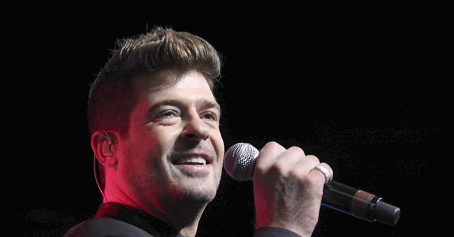 Robin Thicke, model expecting baby on Alan Thicke's birthday