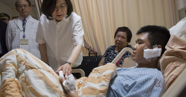 Assailant injures guard outside Taiwan presidential office