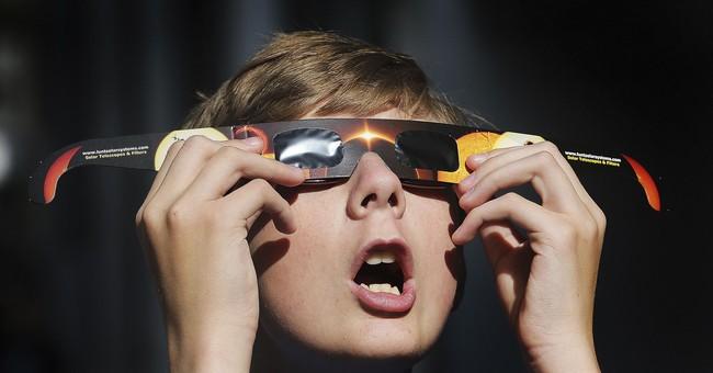 Eclipse eve: Millions converge across US to see sun go dark