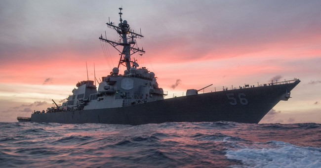 The Latest: Divers assessing damage on USS John S. McCain