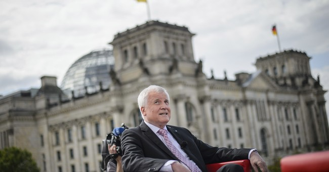 Merkel ally drops call for cap on refugees entering Germany