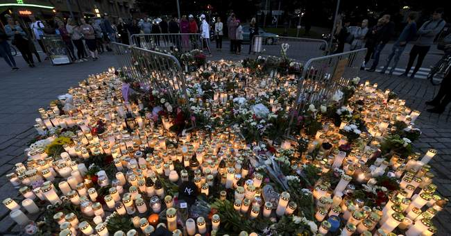 Finland honors stabbing victims; wounded suspect questioned