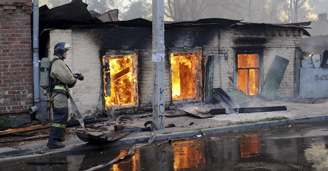 Fire sweeps across Russian city, dozens of homes destroyed