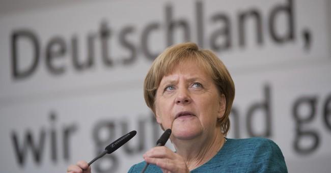 Merkel welcomes release of German-Turkish author in Spain